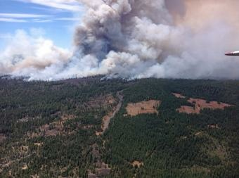 The Eiler Fire had burned 23,000 acres Sunday, with no containment, forcing evacuation for nearby communities.