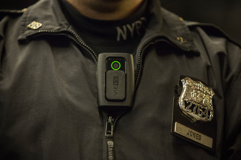 New York Police Department (NYPD) Officer Joshua Jones demonstrates how to use and operate a body camera during a press conference on December 3, 2014 in New York City.