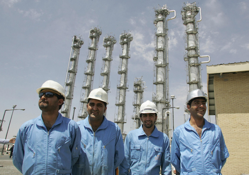Iranian employees pose for a picture at the newly opened heavy water plant in Arak, in 2006. Iran is negotiating with six world powers on the fate of the plant and other issues concerning its nuclear program.