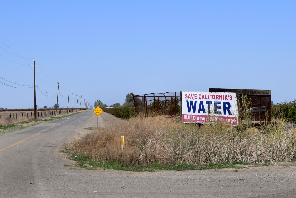 A sign calls for dam water to help the agricultural communities of California's San Joaquin Valley on the outskirts of Lemoore, California on March 31, 2021.