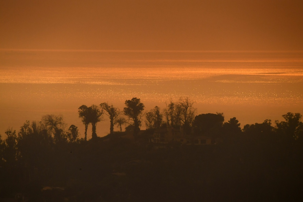 The mid-afternoon view of the Pacific Ocean from a hillside in Montecito, California is orange due to smoke from the Thomas Fire on December 16, 2017.