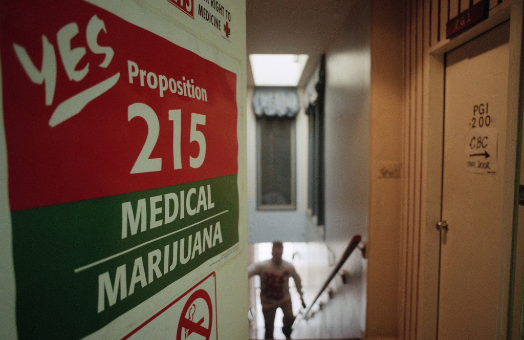 A staff member of the Cannabis Buyers Club walks up the stairs to the club in the Hollywood section of Los Angeles on election eve on Tuesday, Nov. 5, 1995 in Los Angeles. One of the propositions voters in California will decide on is whether to legalize marijuana for medical purposes. The Cannabis Buyers Club sells marijuana to patients who can prove, with a doctors prescription, that they need the product for certain medical reasons.