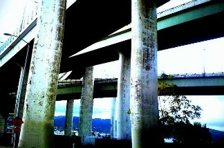 A gritty image of a Portland freeway overpass.