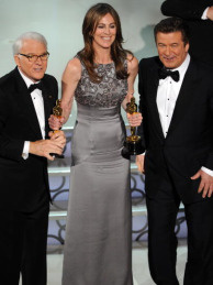Kathryn Bigelow clutching two Oscars (for Best Picture and Best Director of the Hurt Locker), flanked by co-hosts Steve Martin and Alec Baldwin.