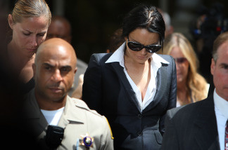 Actress Lindsay Lohan leaves the Beverly Hills Courthouse where she appeared for a probation status hearing on May 24, 2010 in Beverly Hills, California. A judge ordered Lohan to wear an alcohol-monitoring ankle bracelet. (Photo by David McNew/Getty Images)