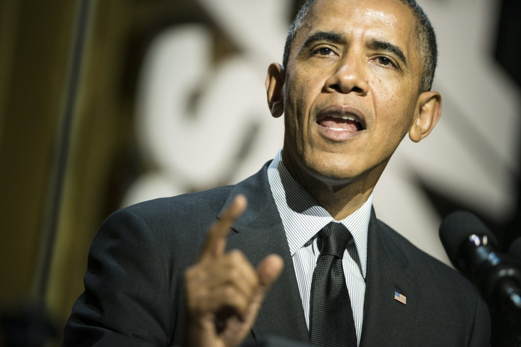 US President Barack Obama speaks during the University of Southern California Shoah Foundation Ambassadors for Humanity 20th anniversary dinner May 7, 2014 in Los Angeles, California. Obama attended the dinner while spending three days in California fund raising.