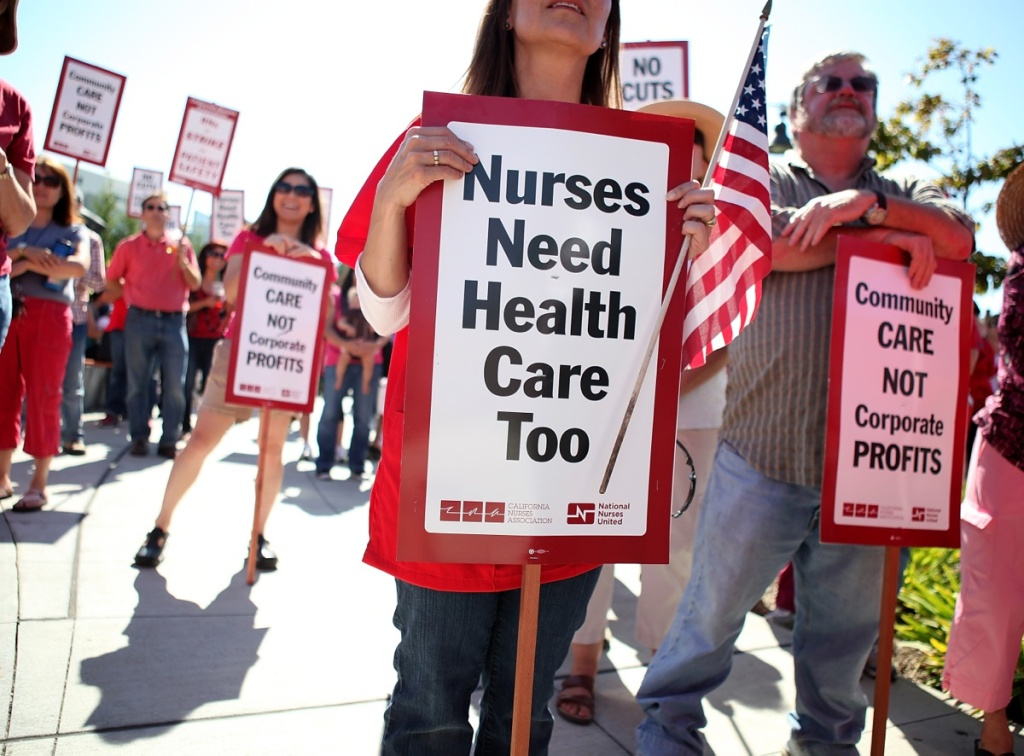 Registered nurses hold signs as they strike outside of the Mills-Peninsula hospital on September 22, 2011 in Burlingame, California. Tens of thousands of registered nurses held a one-day strike at more than thirty Sutter Health and Kaiser Permanente hospitals in northern and central California to protest proposed cuts to benefits and other concessions sought by hospital management.