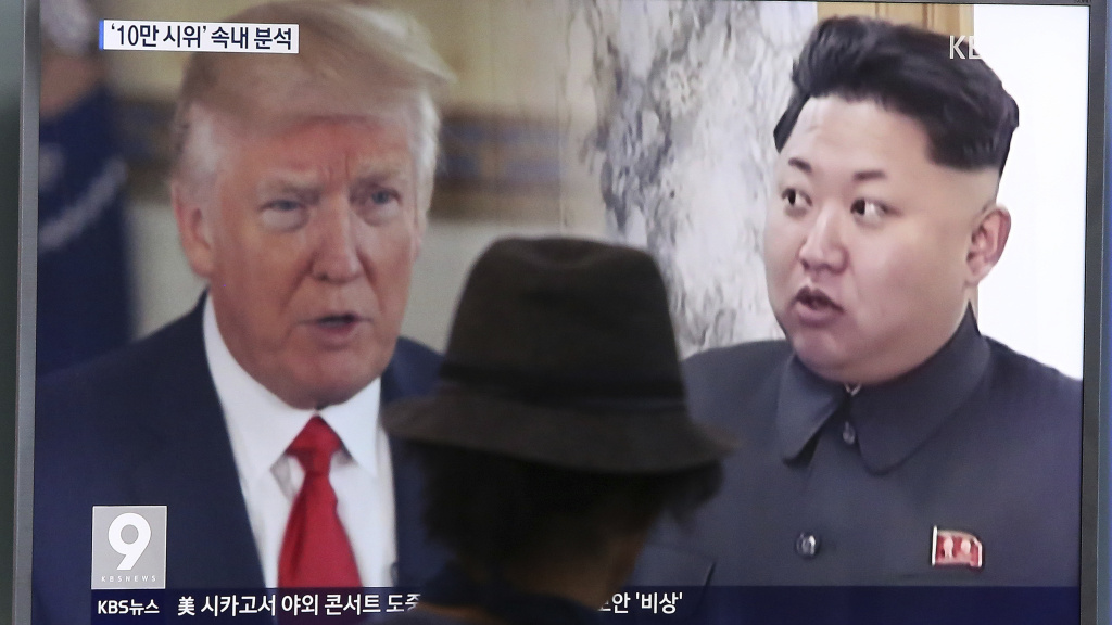 A man at the Seoul, South Korea, train station last August watches a news program featuring President Trump and North Korean leader Kim Jong Un.
