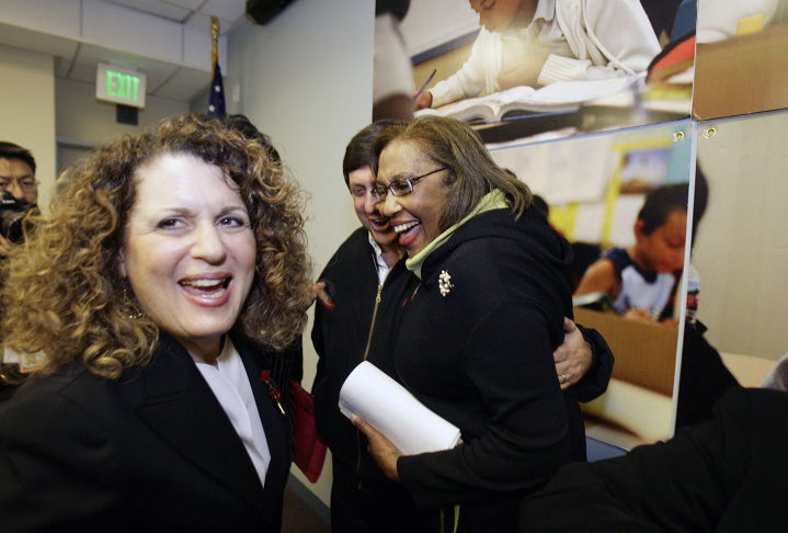 Board of Education president Marlene Canter, left, reacts Thursday, Dec. 21, 2006, to a judge's ruling striking down a law that granted Los Angeles Mayor Antonio Villaraigosa partial control of the nation's second-largest school district. Board member Marguerite P. Lamotte, right, gets a hug.