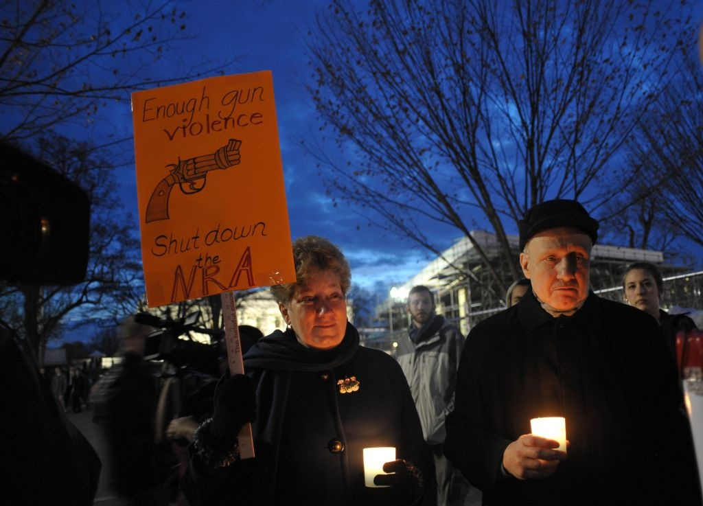 Gun control supporters take part in a candlelight vigil at Lafayette Square across from the White House on December 15, 2012 in Washington. Twenty-seven people, including the shooter, were killed on December 14 at Sandy Hook Elementary School in Newtown, Connecticut.