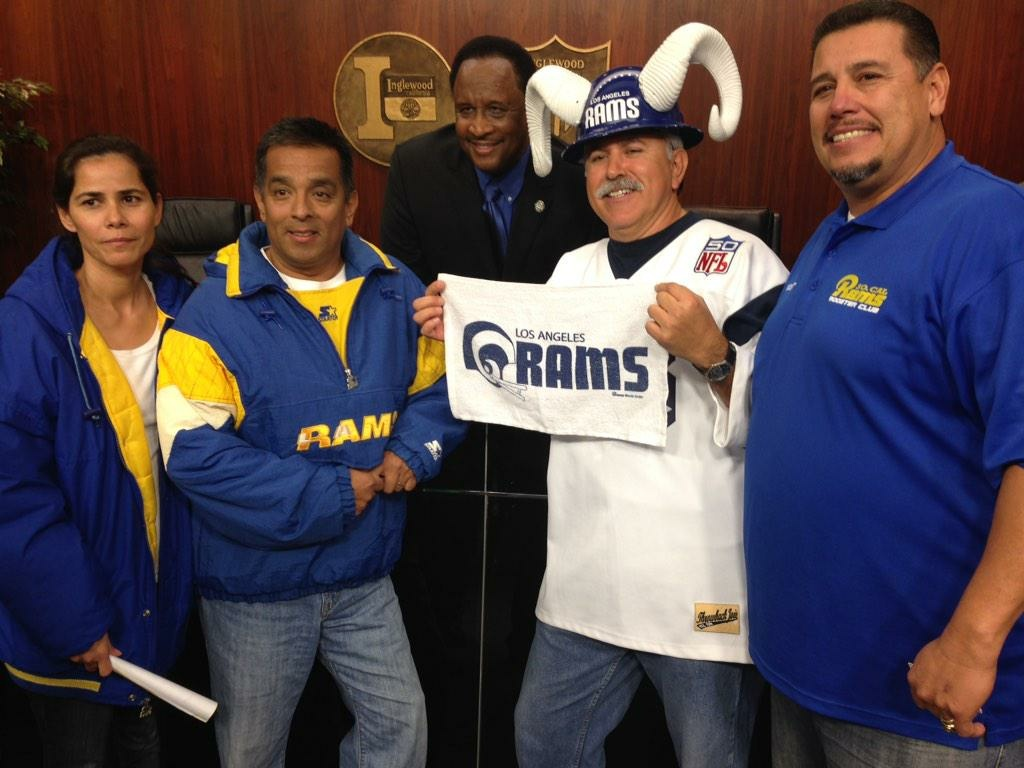 Inglewood's mayor poses with L.A. Rams fans at an Inglewood City Council meeting.