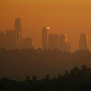 LOS ANGELES, CA - NOVEMBER 17:  The downtown skyline is enveloped in smog shortly before sunset on November 17, 2006 in Los Angeles, California. Earlier this month, the South Coast Air Quality Management District, southern California?s anti-smog agency, approved a $36 million program to reduce pollution from trucks operating at the twin ports of Los Angeles and Long Beach. An estimated 12,000 diesel trucks travel to and from the ports each day, carrying freight through southern California metropolitan areas where their emissions are believed to increased risks of asthma and other illnesses among local residents and particularly children.  (Photo by David McNew/Getty Images)