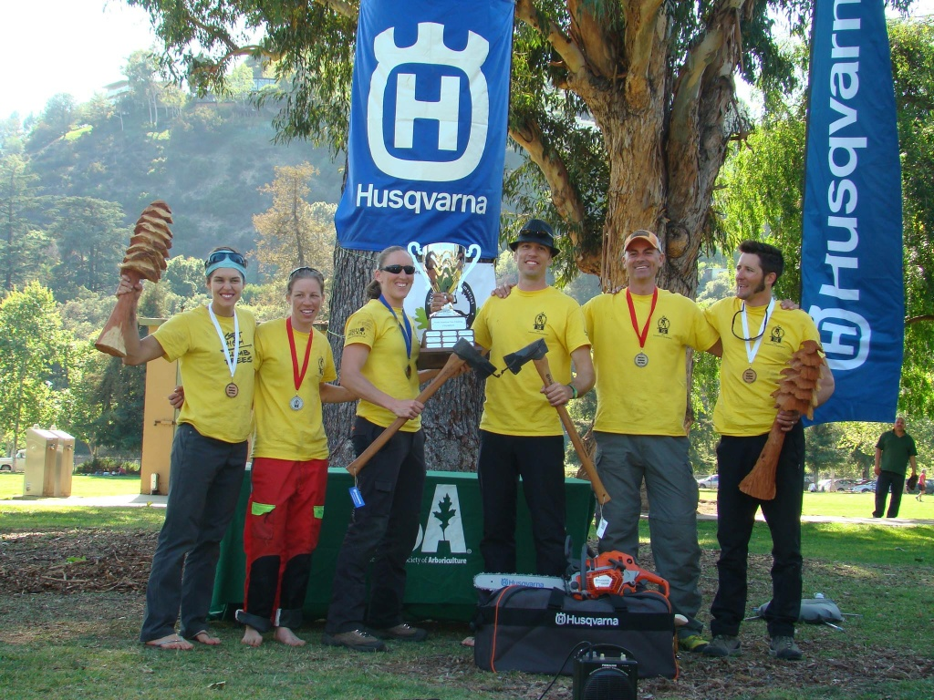Jamilee Kempton (first on the left) and Chad Brey (third to the right) pose with fellow winners of the 2014 North American Tree Climbing Championship.