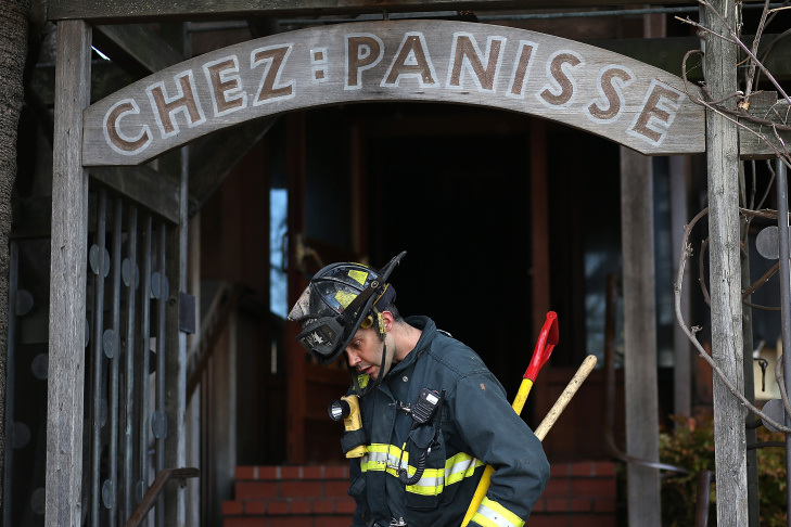 A Berkeley Fire Department firefighter walks out of Chez Panisse restaurant after an early morning fire on March 8, 2013 in Berkeley, California.