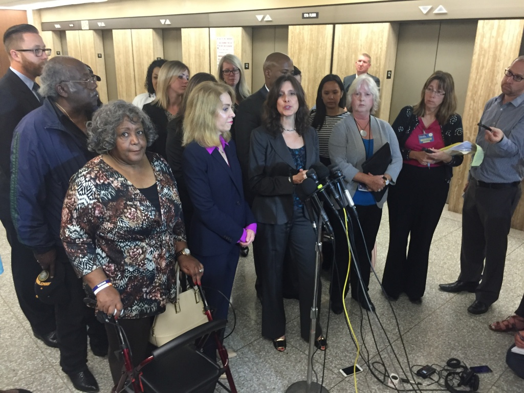 Lead prosecutor Beth Silverman is surrounded by colleagues and victims' family members after a jury delivered the death penalty to Lonnie Franklin Jr. (AKA the Grim Sleeper), who was convicted of murdering 10 women in South L.A. from 1985 to 2007.