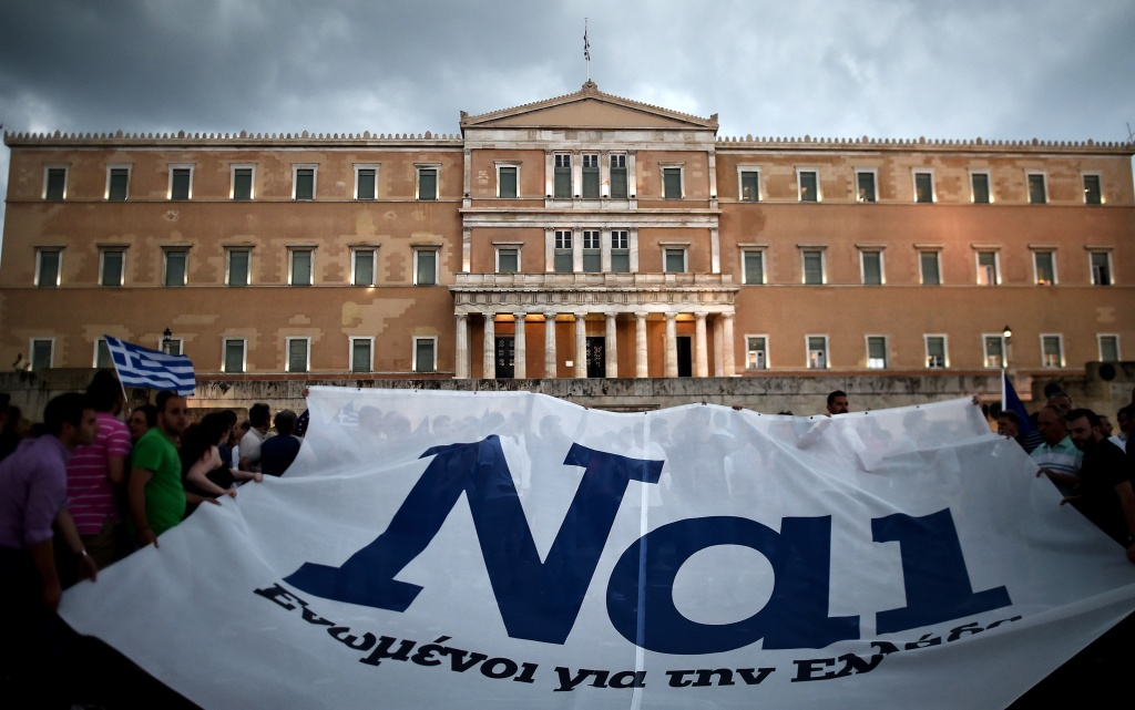 Pro-euro protesters hold a banner reading ''YES