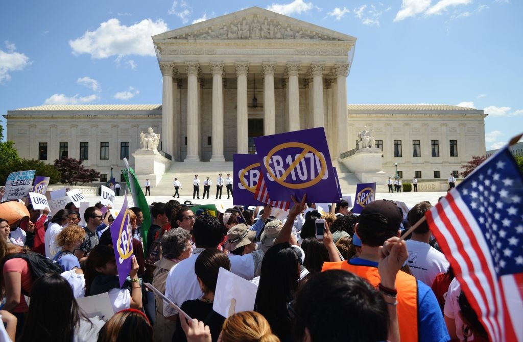 Protesters opposed to Arizona's immigration law SB 1070 in front of the U.S. Supreme Court earlier this year.