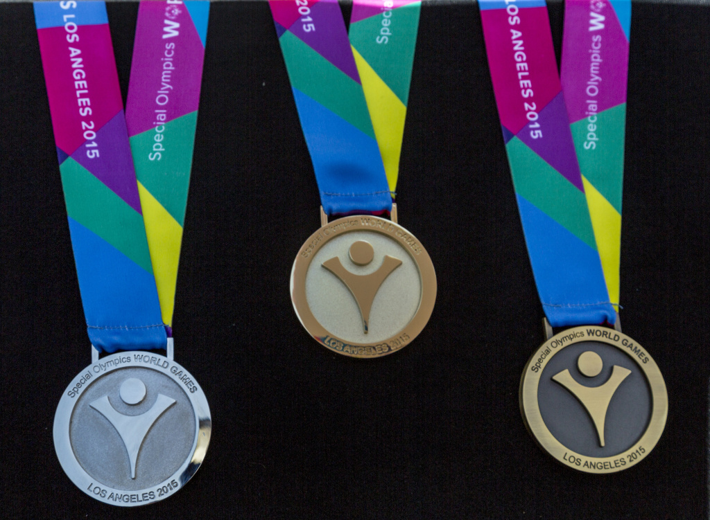 In this April 16, 2015, file photo, the 2015 Special Olympics World Games medals are unveiled for the 2015 Special Olympics World Games at the LA84 Foundation in Los Angeles.