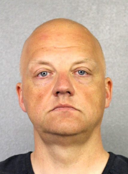 This photo provided by the Broward County Sheriff's Office shows Oliver Schmidt under arrest on Jan. 7, 2017. Schmidt, the general manager of the engineering and environmental office for Volkswagen America, was arrested in connection with the company's emissions-cheating scandal. He has an appearance in Miami Federal Court, Monday, Jan. 9, 2017.
