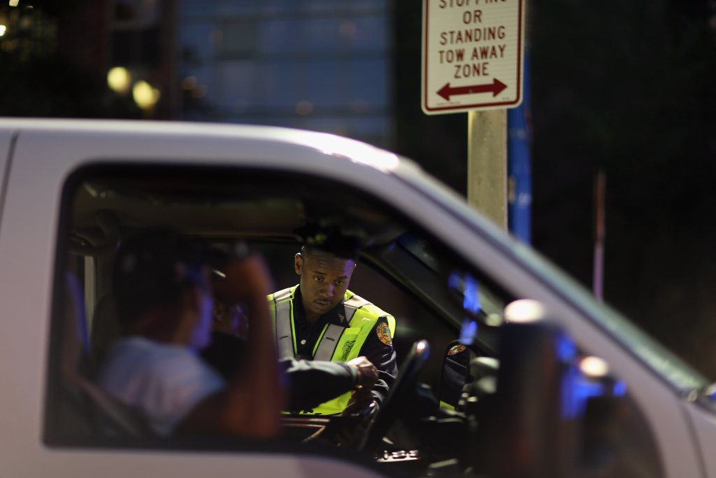 City of Miami police officer Allixen Stevens II speaks to a driver during a  DUI checkpoint on  in Miami, Florida. The National Transportation Safety Board recently recommended that states should lower the legal limit of blood alcohol content that indicates drunken driving - currently 0.08 nationwide - to 0.05. States determine the limit, but the federal government can pressure states to meet its standard.