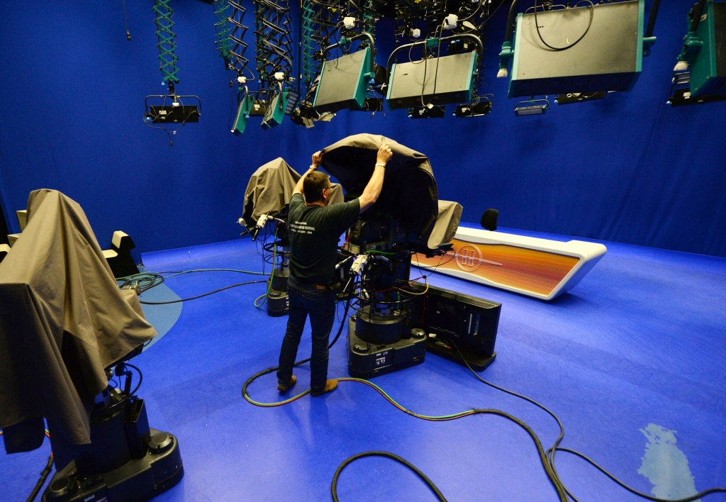 A cameraman covers a camera in a TV studio of the independent tv network RTL Klub, Hungary's largest commercial media company in Budapest on June 5, 2014.
