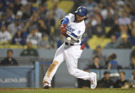 Alex Verdugo #27 of the Los Angeles Dodgers hits a double in the eighth inning against the New York Mets at Dodger Stadium on May 30, 2019 in Los Angeles, California.