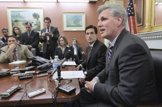 House Majority Leader Eric Cantor of Va. (left) and House Majority Whip Kevin McCarthy of Calif. (right) meet reporters on Capitol Hill in Washington, D.C., on March 14, 2011, as Congress resumes work on another contentious short-term spending bill to keep the government running.