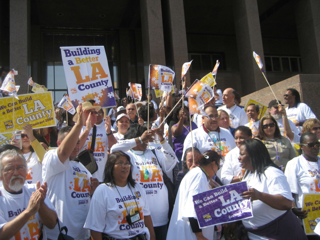 Members of SEIU Local 721 gather in front of Kenneth Hahn Hall of Administration.