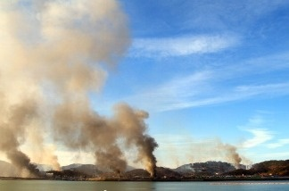 Huge plumes of smoke rising from Yeonpyeong island in the disputed waters of the Yellow Sea on November 23, 2010.