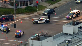 Police vehicles block an intersection where a shooting occurred in Tustin. It is one of several locations where shootings were reported early Tuesday morning.