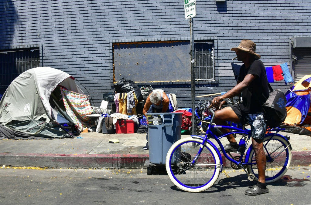 Tents and belongings of the homeless line a street in downtown Los Angeles, California on June 25, 2018.