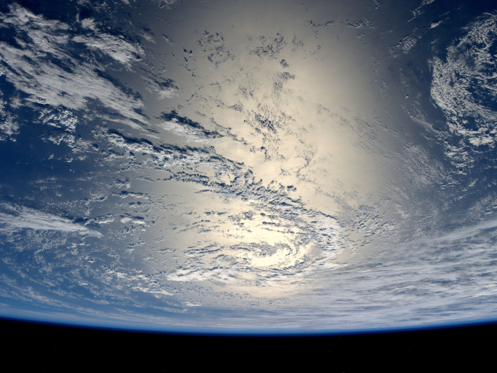 German ESA astronaut Alexander Gerst took this image of the Earth reflecting light from the sun while aboard the International Space Station July 17, 2014.