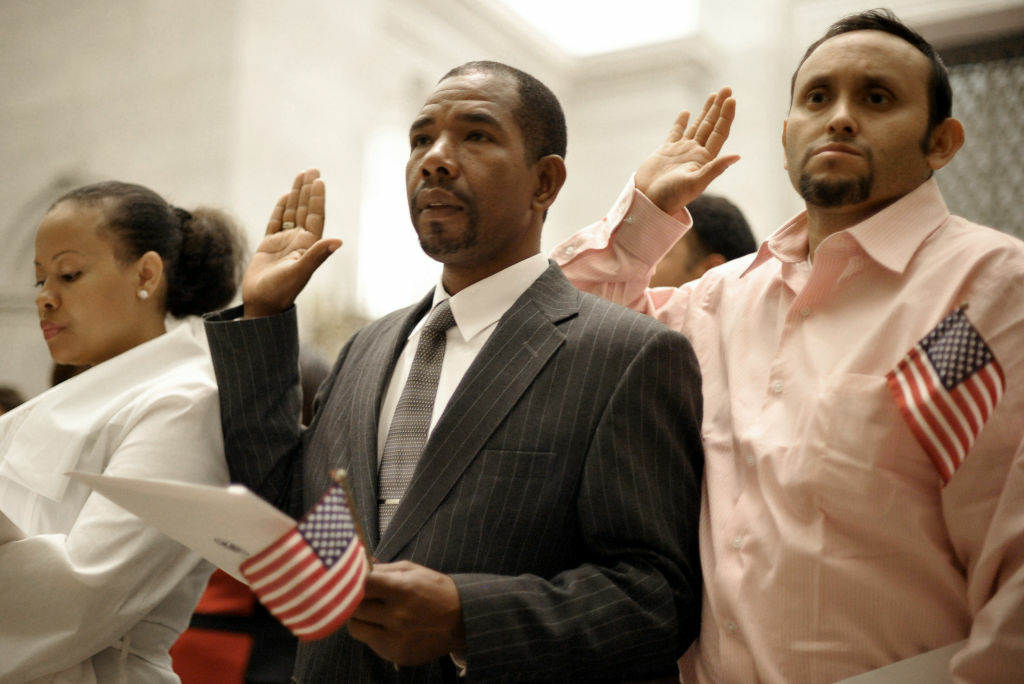 New United States citizens are sworn in during a naturalization ceremony September 17, 2012 at the National Archives in Washington, DC. Recent surveys have suggested there is growing support for a path to citizenship, and even more so for legal status, for the estimated 11 million undocumented immigrants living in the U.S.