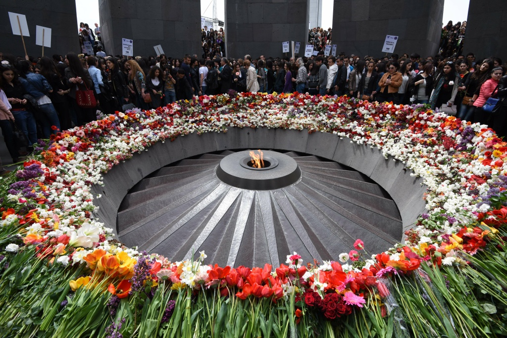 People lay flowers at the Tsitsernakaberd Armenian Genocide Memorial in Yerevan on April 21,2015. Armenians prepare to commemorate on April 24 a hundred years since 1.5 million of their kin were massacred by Ottoman forces, as a fierce dispute still rages with Turkey over Ankara's refusal to recognize the mass murder as genocide.