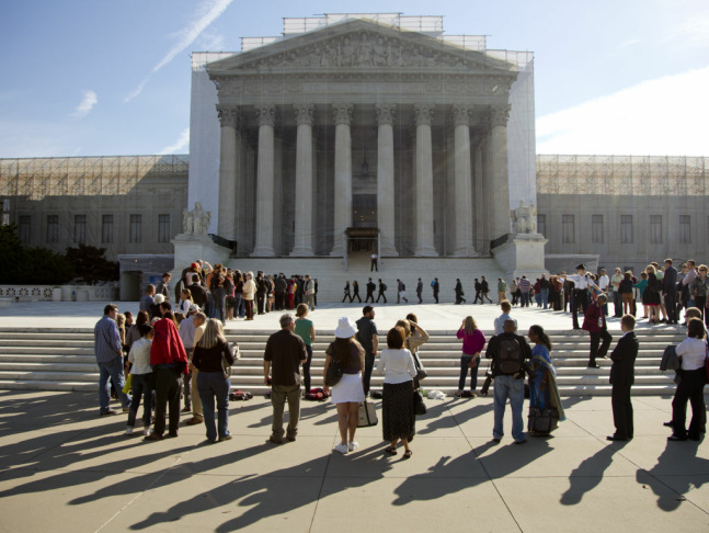 Field Director Charles White of the National Association for the Advancement of Colored People (NAACP) speaks at a podium outside the U.S. Supreme Court on Tuesday in Washington, D.C.