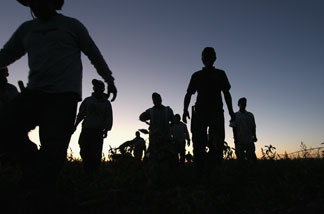 Migrant farm workers finish a long day of harvesting organic vegetables at Grant Family Farms on September 3, 2010 in Wellington, Colorado.