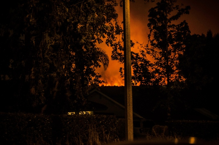 The view of the fire on the night of Saturday, April 18, 2015, from the community at Auburndale and River in Corona.
