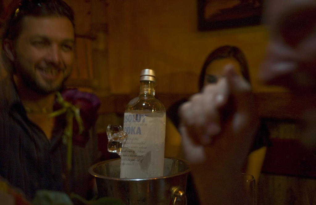 A picture taken on July 6, 2012 shows a couple enjoying the night with a bottle of vodka in a bar.