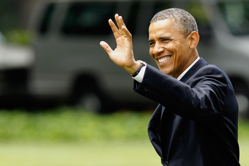 U.S. President Barack Obama waves as he walks across the South Lawn before boarding Marine One and departing the White House June 25, 2012 in Washington, DC.
