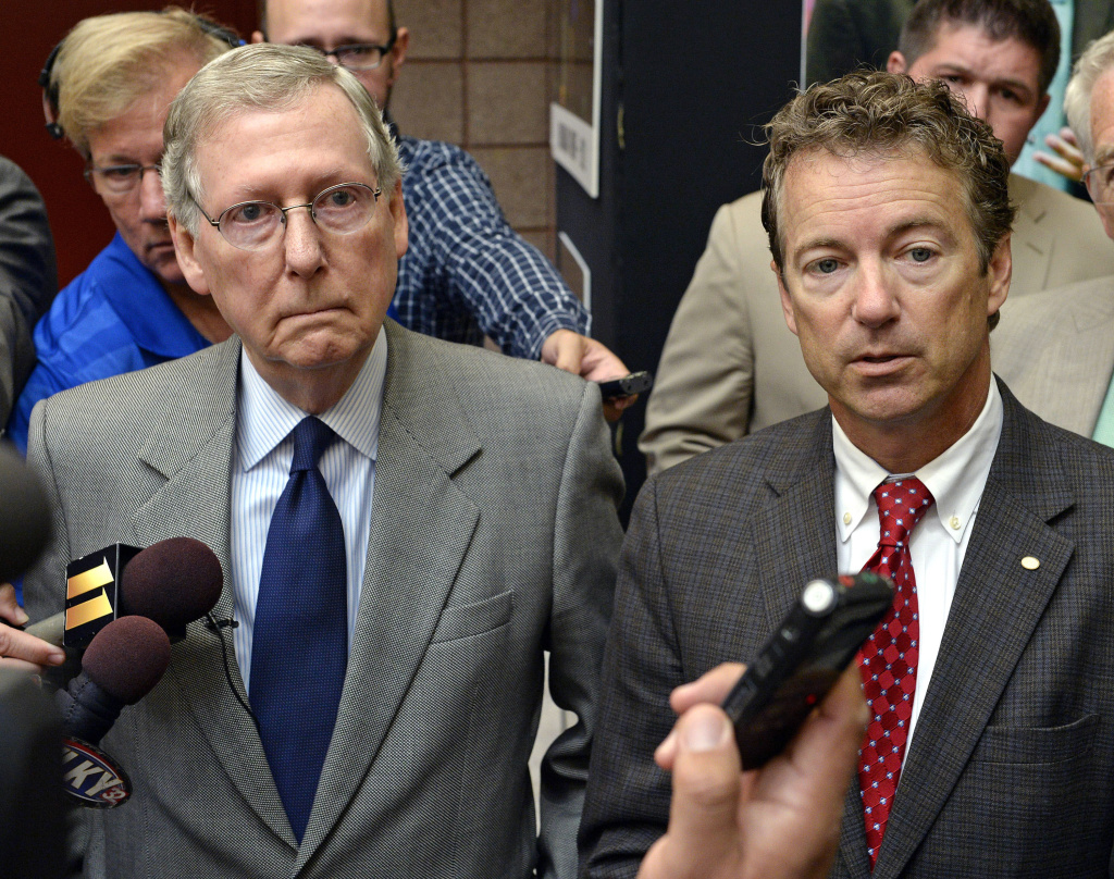 Kentucky Sens. Mitch McConnell, left, and Rand Paul speak with reporters following their appearance at the 50th annual Kentucky Country Ham Breakfast, Thursday, Aug. 22, 2013 at the Kentucky State Fairgrounds in Louisville, Ky.