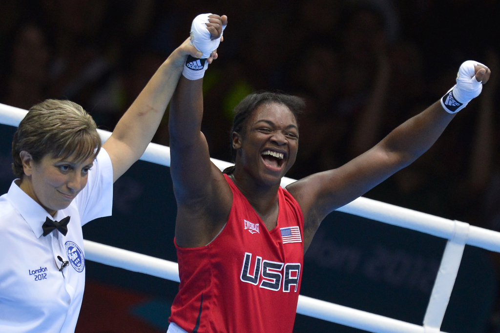 Claressa Shields of the USA (R) celebrates defeating Nadezda Torlopova of Russia to win gold during the women's boxing Middleweight of the 2012 London Olympic Games at the ExCel Arena August 9, 2012 in London.