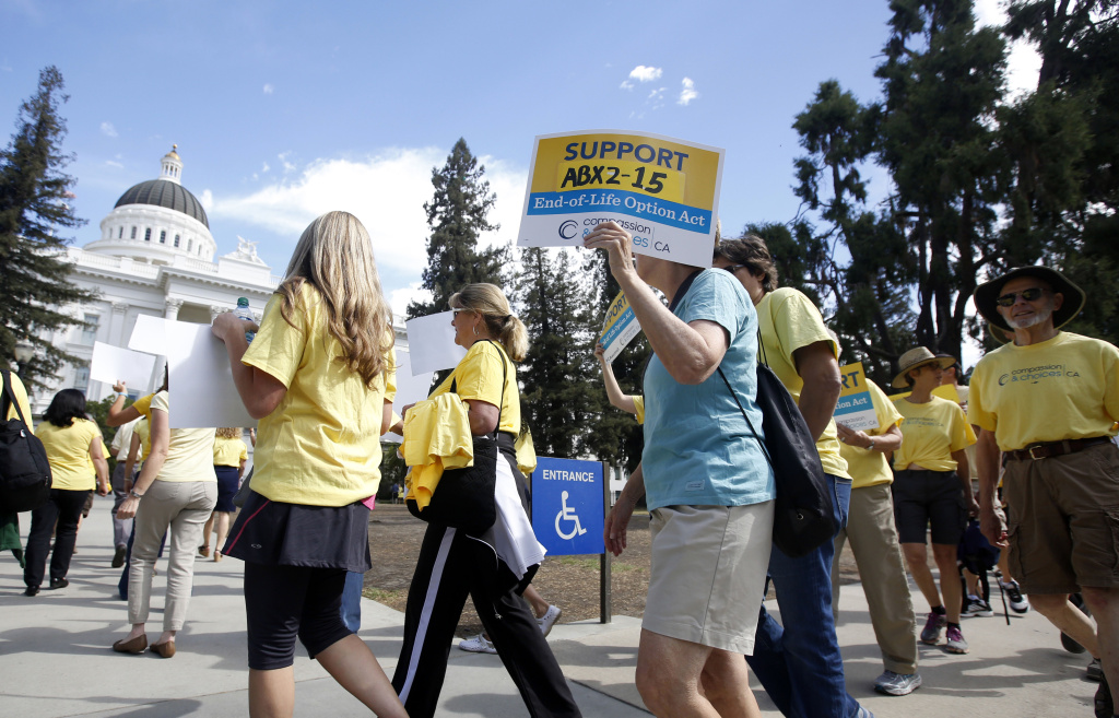 Supporters of the End of Life Option Act march at the state Capitol in Sept. 2015.