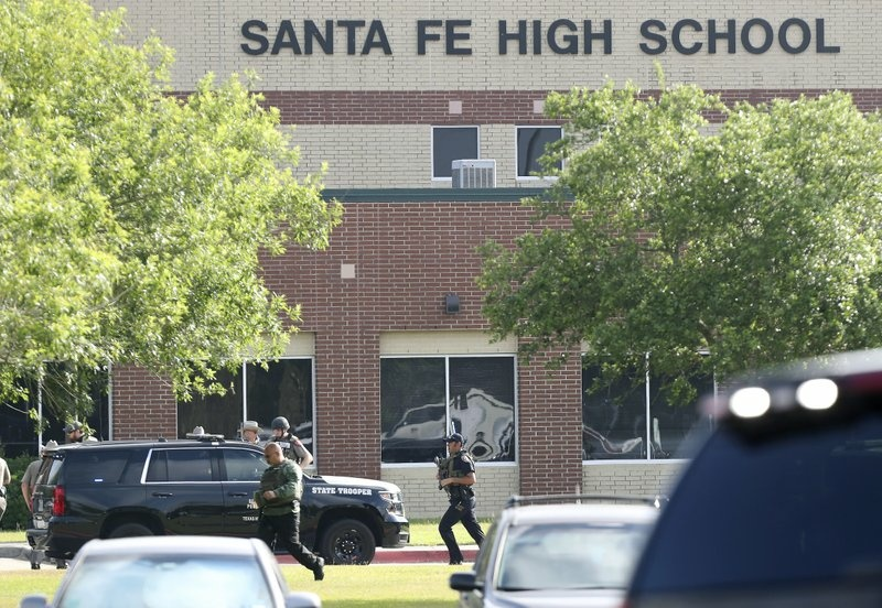 Law enforcement officers respond to Santa Fe High School after an active shooter was reported on campus, Friday, May 18, 2018, in Santa Fe, Texas.