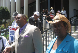 Activists Joyce Kelly and William Kemp on steps of Compton City Hall, August 12, 2010.