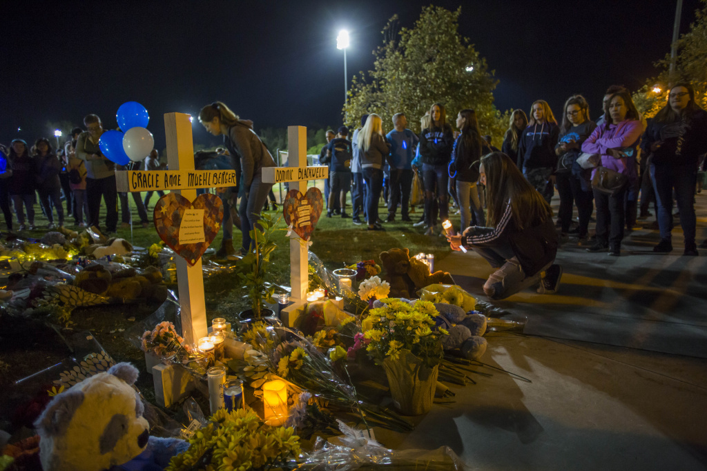 Mourners gather at a vigil held for shooting victims on November 17, 2019 in Santa Clarita, California.