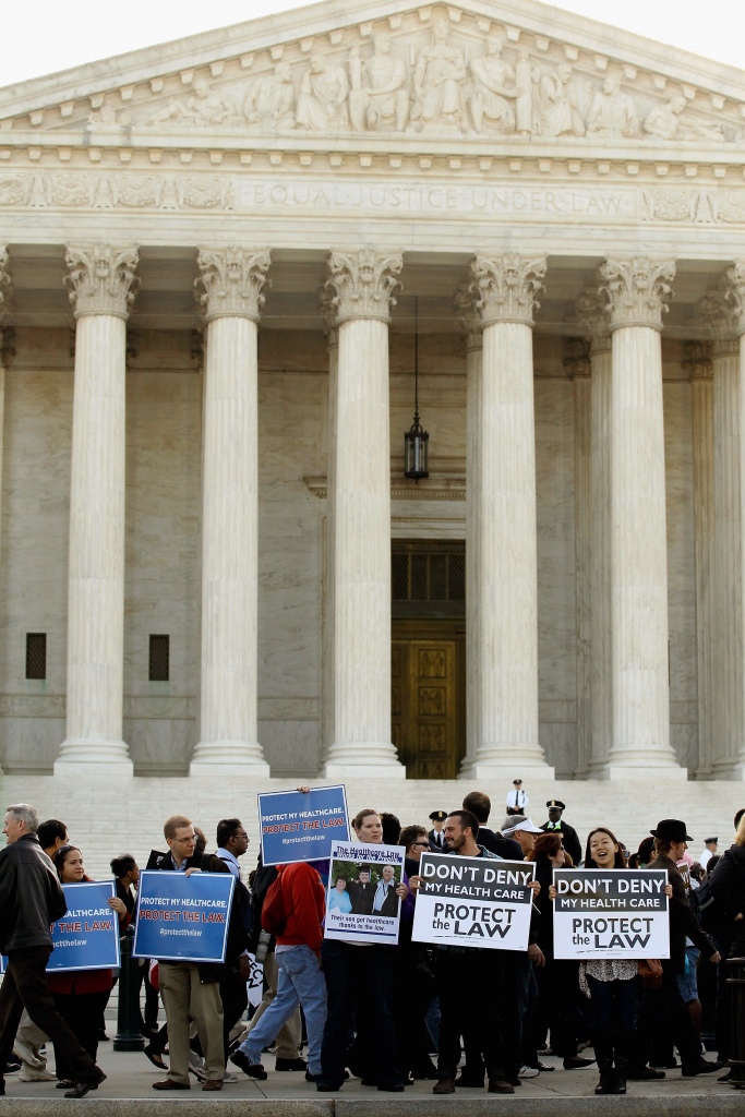 Demonstrators for and against the Patient Protection and Affordable Care Act march and chant in outside the U.S. Supreme Court Building on March 26, 2012 in Washington, DC. The high court, which has set aside six hours over three days, will hear arguments over the constitutionality of the act.