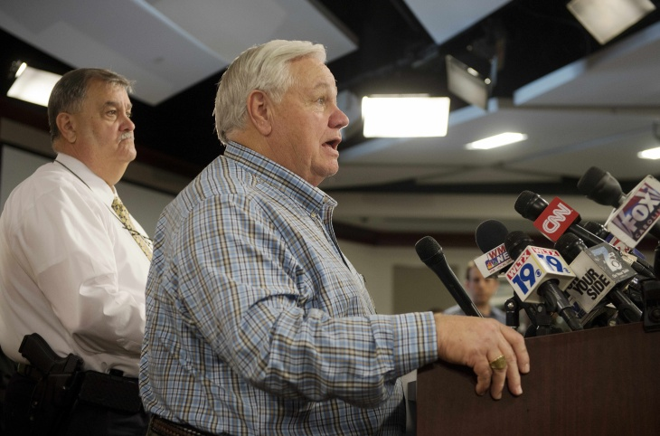 North Charleston Mayor R. Keith Summey (C) and Police Chief Eddie Driggers (L) speak during a press conference at City Hall in Charleston, South Carolina on April 8, 2015.  The white police officer who fatally shot a fleeing black man in the US city of North Charleston has been fired after he was charged with murder, the mayor said. A police officer shot Walter Scott, 50, repeatedly in the back on Saturday after a scuffle that began with his being stopped for a broken tail light in his car.
