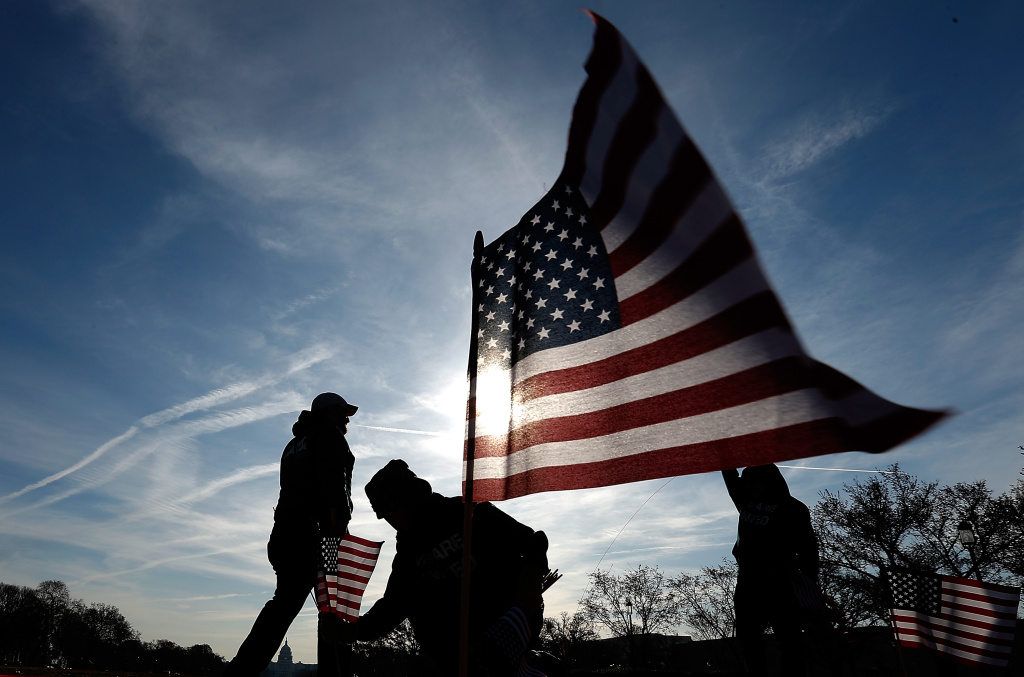 U.S. military veterans set up 1,892 American flags on the National Mall March 27, 2014 in Washington, DC. The Iraq and Afghanistan Veterans of America installed the flags to represent the 1,892 veterans and service members who committed suicide this year as part of the