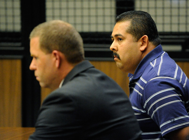 A trial date was set Friday for October 18, 2013 for two former Fullerton police officers in connection with the beating death of Kelly Thomas. (Photo: Handcuffed ex-Fullerton police officer Manuel Ramos (R) was charged with second-degree murder and involuntary manslaughter and Cpl. Jay Cicinelli (L) charged with involuntary manslaughter and use of excessive force for the death of Kelly Thomas, a schizophrenic homeless man who died after altercation with several police officers, during arraignment in Orange County Superior Court on Sept. 21, 2011 in Santa Ana.)