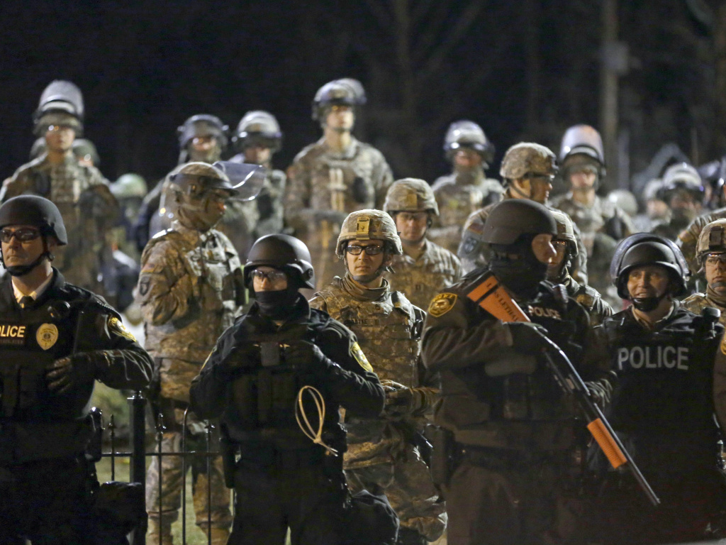 Heavily militarized local and state police responding to protests in Ferguson, Missouri, after the 2014 fatal shooting of Michael Brown.